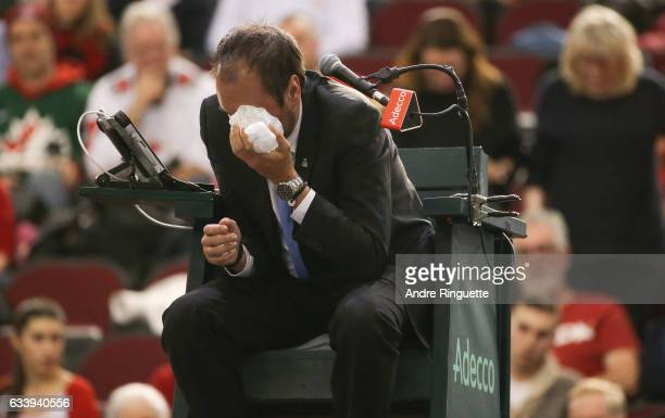 Chair umpire Arnaud Gabas reacts to getting hit in the eye with a ball hit by Denis Shapovalov of Canada during the singles match between Kyle Edmund...