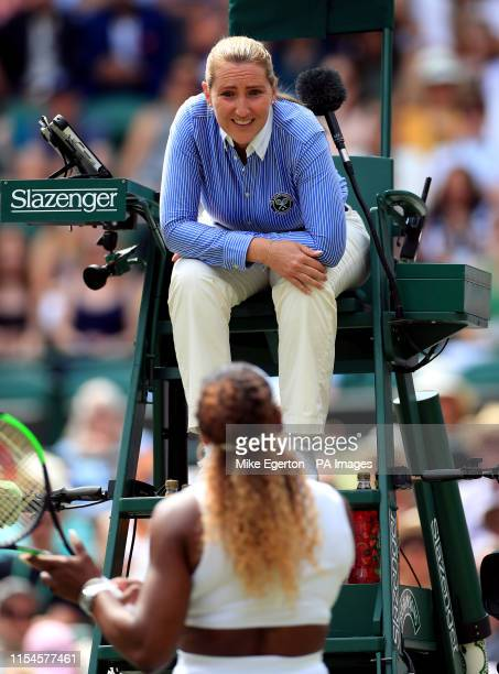 Chair umpire Aurelie Tourte speaks to Serena Williams after she penalises her for playing a shot on the wrong side of the net on day seven of the...