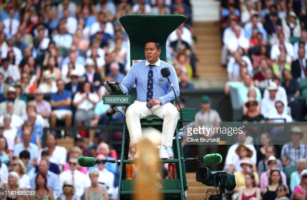 Chair umpire James Keothavong looks on in the Men's Singles semi-final match between Rafael Nadal of Spain and Roger Federer of Switzerland during...