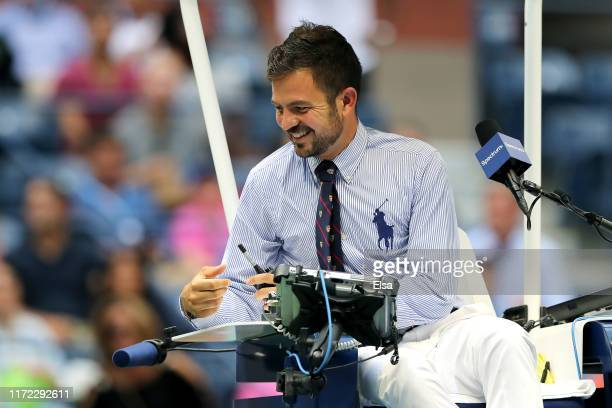 Chair umpire Jaume Campistol looks on during the Men's Singles quarterfinal match between Matteo Berrettini of Italy and Gael Monfils of France on...