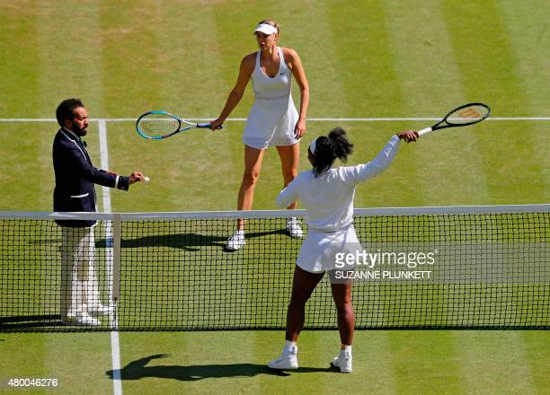 Chair umpire Kader Nouni conducts the toss at the start of the women's semifinal match between US player Serena Williams and Russia's Maria Sharapova...