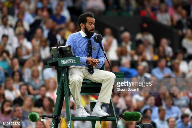 Chair umpire Kader Nouni looks on during the Ladies Singles quarter final match between Johanna Konta of Great Britain and Simona Halep of Romania on...