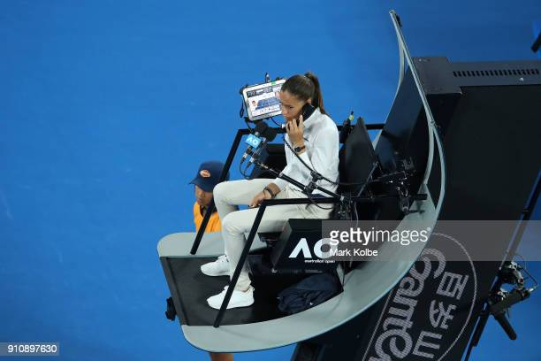 Chair umpire Marijana Veljovic asks for medical assistance for Simona Halep of Romania in the women's singles final with Caroline Wozniacki of...