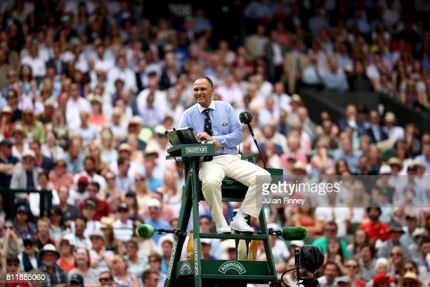 Chair umpire Mohamed Lahyani looks during the Gentlemen's Singles fourth round match between Andy Murray of Great Britain and Benoit Paire of France...