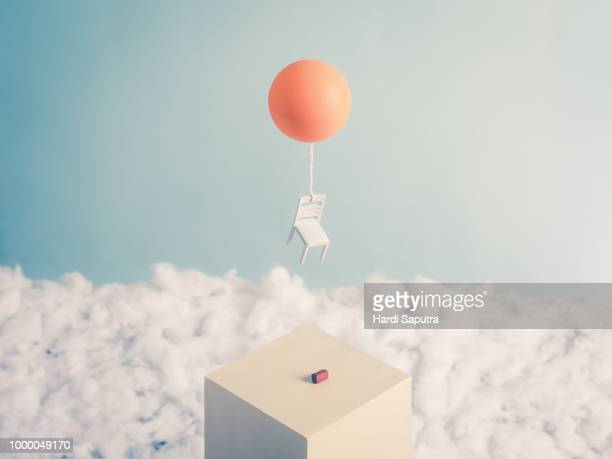 chair with balloon flying away - cartoon stock pictures, royalty-free photos & images