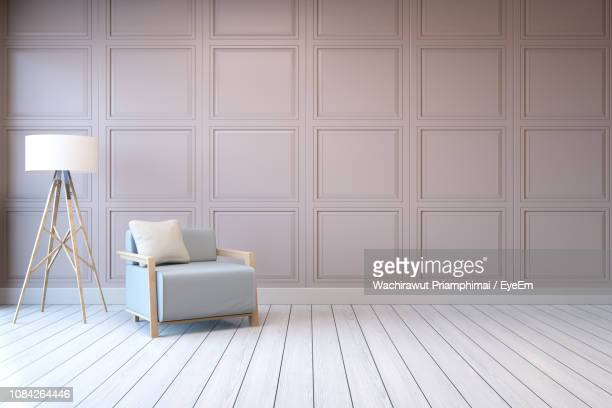 chair with floor lamp by wall at home - beige stock pictures, royalty-free photos & images