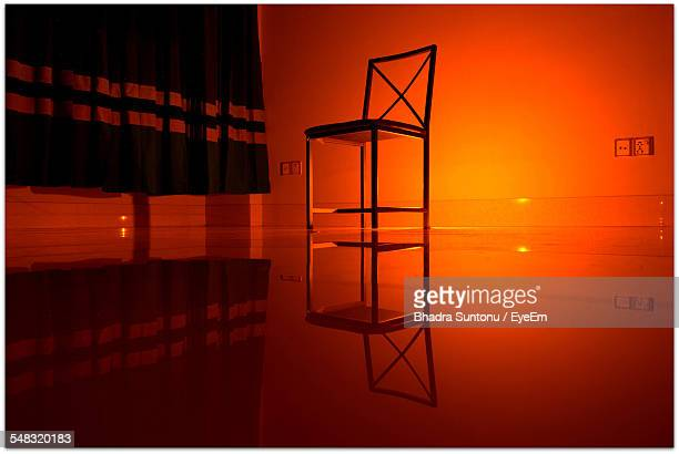 Chair With Reflective Floor In Empty Room