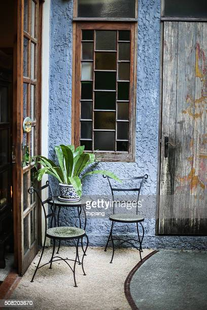 Chair wrought iron by the window standing in vintage house