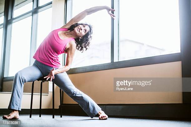 chair yoga - chair stock pictures, royalty-free photos & images