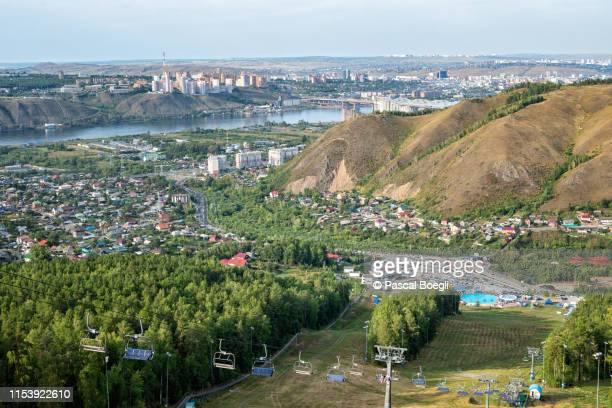 chairlift at the bobrovy log leisure park near krasnoyarsk, siberia, russia - krasnoyarsk stock pictures, royalty-free photos & images