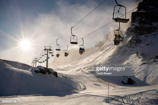 chairlift on ski mountain in dolomites - ski lift stock pictures, royalty-free photos & images