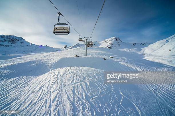 chairlift - ski ressort in the alps - ski lift stock pictures, royalty-free photos & images
