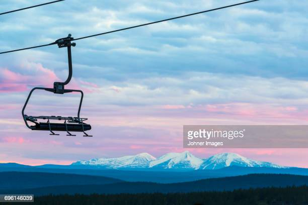 chairlift with mountain landscape in background - ski lift stock pictures, royalty-free photos & images