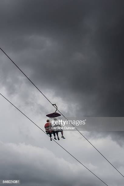 Chairlift with storm clouds building