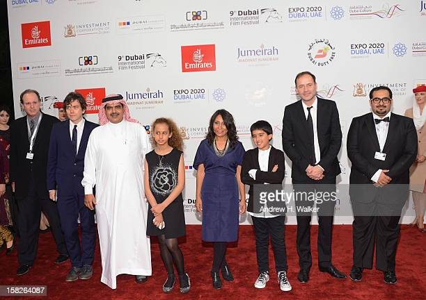 DIFF Chairman Abdulhamid Juma actress Waad Mohammed director Haifaa Al Mansour and actor Abdulrahman al Guhani attend the 'Wadjda' premiere during...