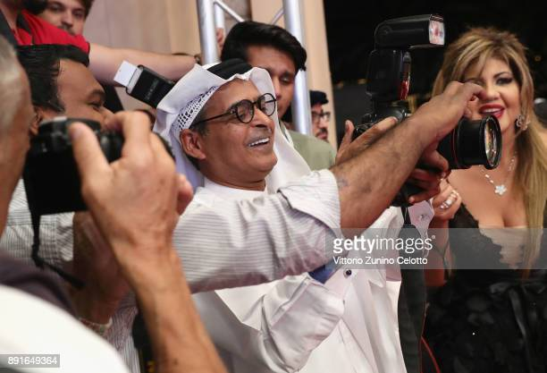 Chairman Abdulhamid Juma joins the photographers at the Star Wars The Last Jedi Closing Night red carpet on day eight of the 14th annual Dubai...