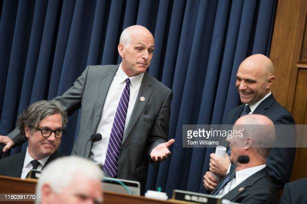 Chairman Adam Smith, D-Wash., talks with ranking member Rep. Mac Thornberry, R-Texas, right, during a House Armed Services Committee markup in...