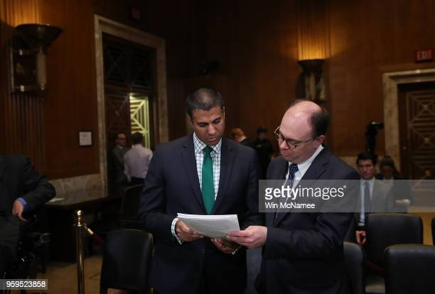 Chairman Ajit Pai confers with an aide prior to testimony before the Senate Appropriations Committee May 17 2018 in Washington DC The committee heard...