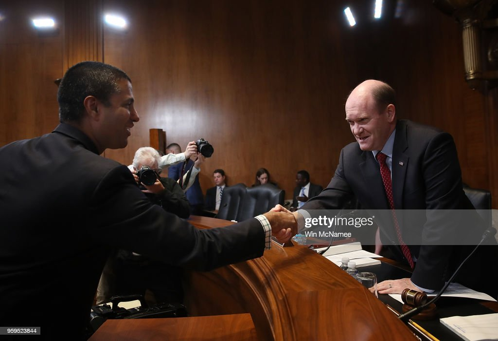 Chairman Ajit Pai (L) greets Sen. Chris Coons (D-DE) prior to testimony before the Senate Appropriations Committee May 17, 2018 in Washington, DC. The committee heard testimony on the proposed budget estimates and justification for fiscal year 2019 for the Federal Communications Commission and the Federal Trade Commission.
