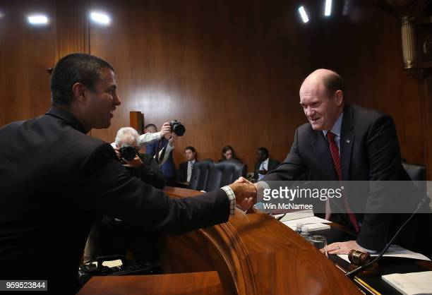 Chairman Ajit Pai greets Sen Chris Coons prior to testimony before the Senate Appropriations Committee May 17 2018 in Washington DC The committee...