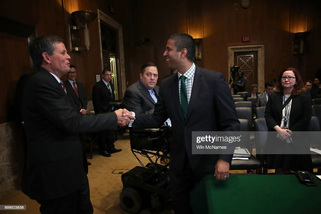 Chairman Ajit Pai (R) greets Sen. Steve Daines (R-MT) prior to testimony before the Senate Appropriations Committee May 17, 2018 in Washington, DC. The committee heard testimony on the proposed budget estimates and justification for fiscal year 2019 for the Federal Communications Commission and the Federal Trade Commission.