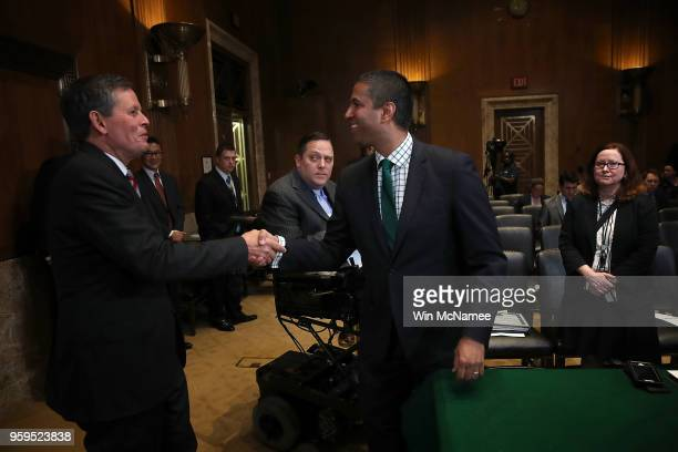 Chairman Ajit Pai greets Sen Steve Daines prior to testimony before the Senate Appropriations Committee May 17 2018 in Washington DC The committee...