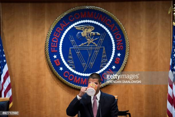 FCC Chairman Ajit Pai listens during a hearing at the Federal Communications Commission on December 14 2017 in Washington DC / AFP PHOTO / Brendan...