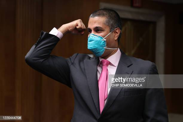 Chairman Ajit Pai says goodby to members of a Senate Appropriations Subcommittee afters testifying during a hearing on Capitol Hill June 16, 2020 in...