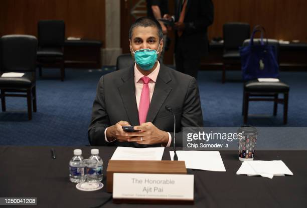 Chairman, Ajit Pai, sits at the witness table before testifying before a Senate Appropriations Subcommittee on Capitol Hill June 16, 2020 in...