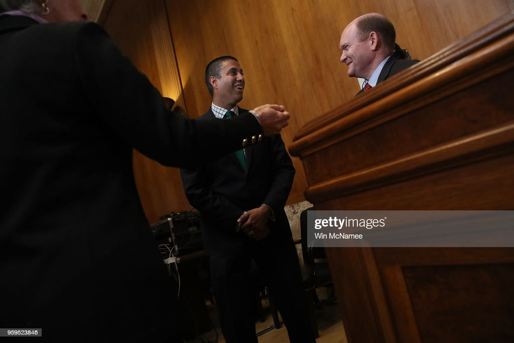 Chairman Ajit Pai (C) speaks with Sen. Chris Coons (R) (D-DE) prior to testimony before the Senate Appropriations Committee May 17, 2018 in Washington, DC. The committee heard testimony on the proposed budget estimates and justification for fiscal year 2019 for the Federal Communications Commission and the Federal Trade Commission.
