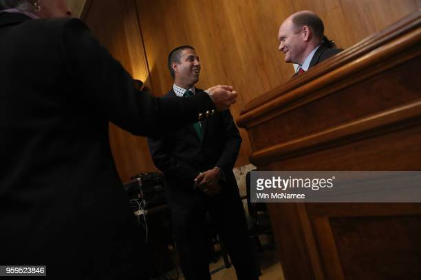 Chairman Ajit Pai speaks with Sen Chris Coons prior to testimony before the Senate Appropriations Committee May 17 2018 in Washington DC The...