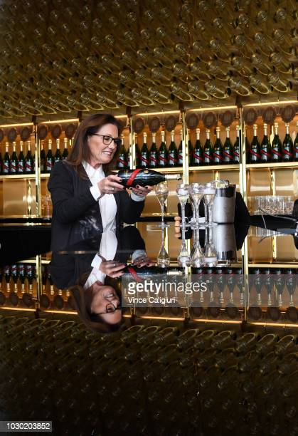 Chairman Amanda Elliott pouring champagne in the GHMumm Champagne bar during a media preview of the new Club Stand at Flemington Racecourse on...