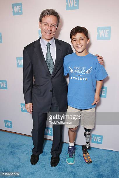 Chairman and CEO at The Allstate Corporation Tom Wilson and Ezra Frech attends the WE Day Celebration Dinner at The Beverly Hilton Hotel on April 6...