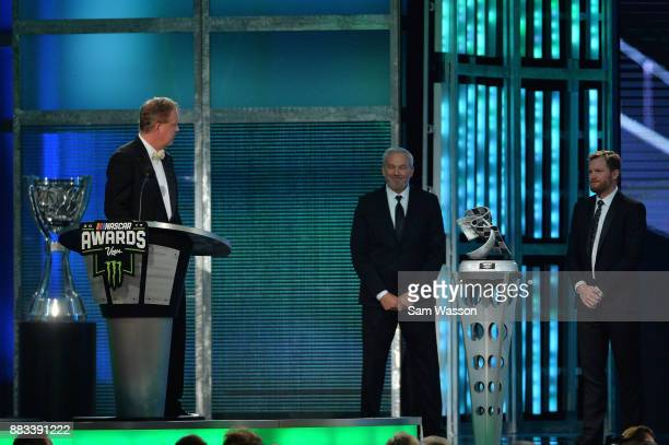 Chairman and CEO Brian France speaks as NASCAR Hall of Famer Dale Jarrett and NASCAR driver Dale Earnhardt Jr look on during the Monster Energy...