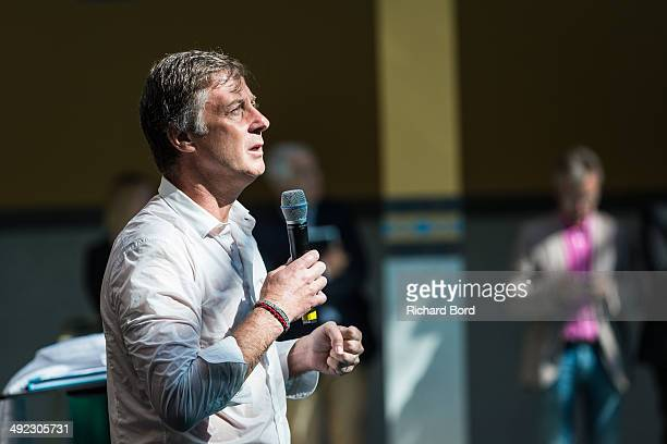 Chairman and CEO of Accor Sebastien Bazin speaks to the guests and medias after a swim in the winter pool at the Piscine Molitor during its...