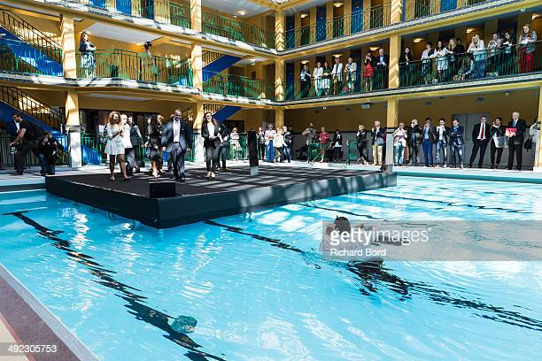 Chairman and CEO of Accor Sebastien Bazin swims in the winter pool at the Piscine Molitor during its inauguration on May 19 2014 in Paris France The...