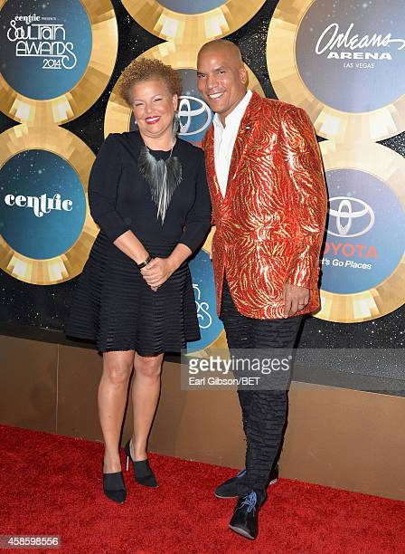 Chairman and CEO of BET Debra Lee and Executive Vice President and General Manager of Centric Paxton Baker attend the 2014 Soul Train Music Awards at...