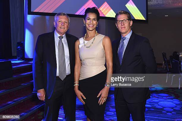 Chairman and CEO of Charter Communications Thomas M Rutledge News Anchor Fredricka Whitfield and John Martin Chairman and CEO Turner attend the 33rd...