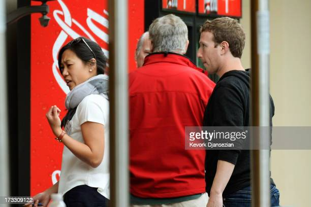 Chairman and CEO of Facebook Mark Zuckerberg follows his wife Priscilla Chan after lunch during the Allen Co annual conference at the Sun Valley...