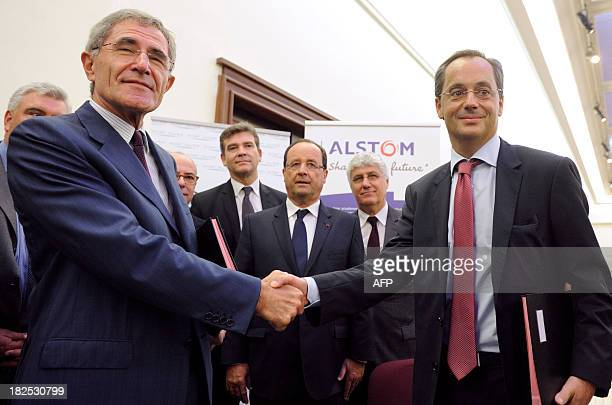Chairman and CEO of GDF Suez Gerard Mestrallet shakes hand with the President of Alstom Renewable Power Jerome Pecresse after signing a contract as...