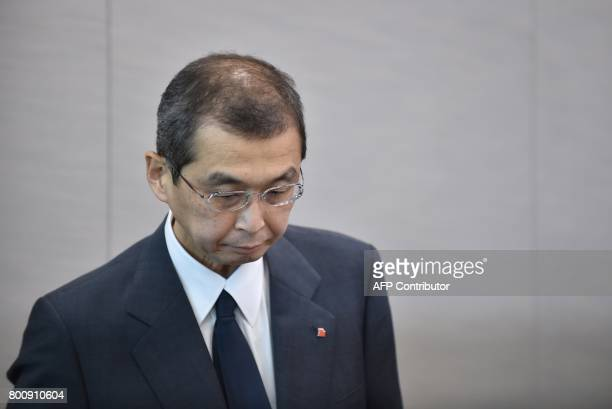 Chairman and CEO of Japanese airbag maker Takata Corp Shigehisa Takada leaves after a press conference in Tokyo on June 26 2017 Japan's crisishit car...