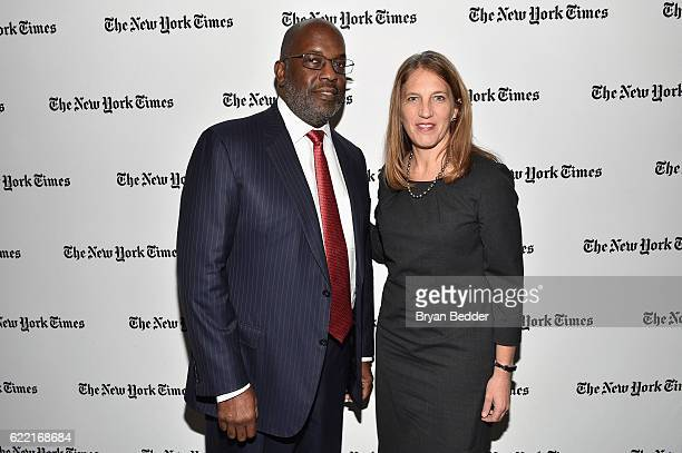 Chairman and CEO of Kaiser Permanente Bernard J Tyson and US Secretary of Health and Human Services Sylvia Mathews Burwell pose backstage at The New...