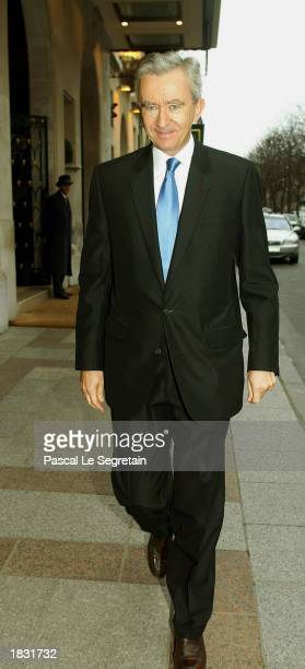 Chairman and CEO of LVMH Moet Hennessy Louis Vuitton Bernard Arnault arrives at the Georges V hotel for his company's 2002 annual report March 6 2003...