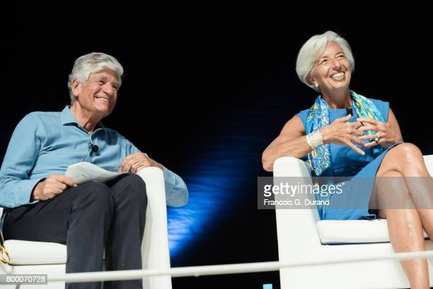 Chairman and CEO of Publicis Groupe Maurice Levy and Managing director of IMF Christine Lagarde give a conference during the Cannes Lions creativity...