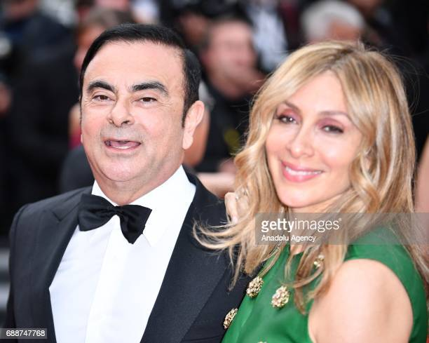 Chairman and CEO of Renault Nissan and Chairman of Mitsubishi Motors Carlos Ghosn and his wife Carole arrive for the premiere of the film L'amant...