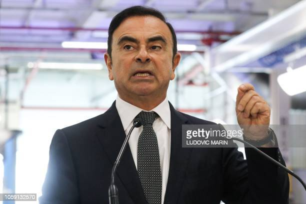Chairman and CEO of RenaultNissanMitsubishi Carlos Ghosn gestures as he delivers a speech during a visit of French President at the Renault factory...