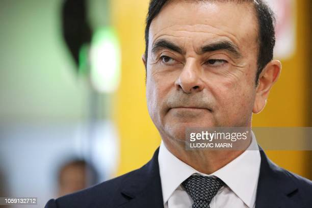 Chairman and CEO of RenaultNissanMitsubishi Carlos Ghosn looks on during a visit of French President at the Renault factory in Maubeuge northern...