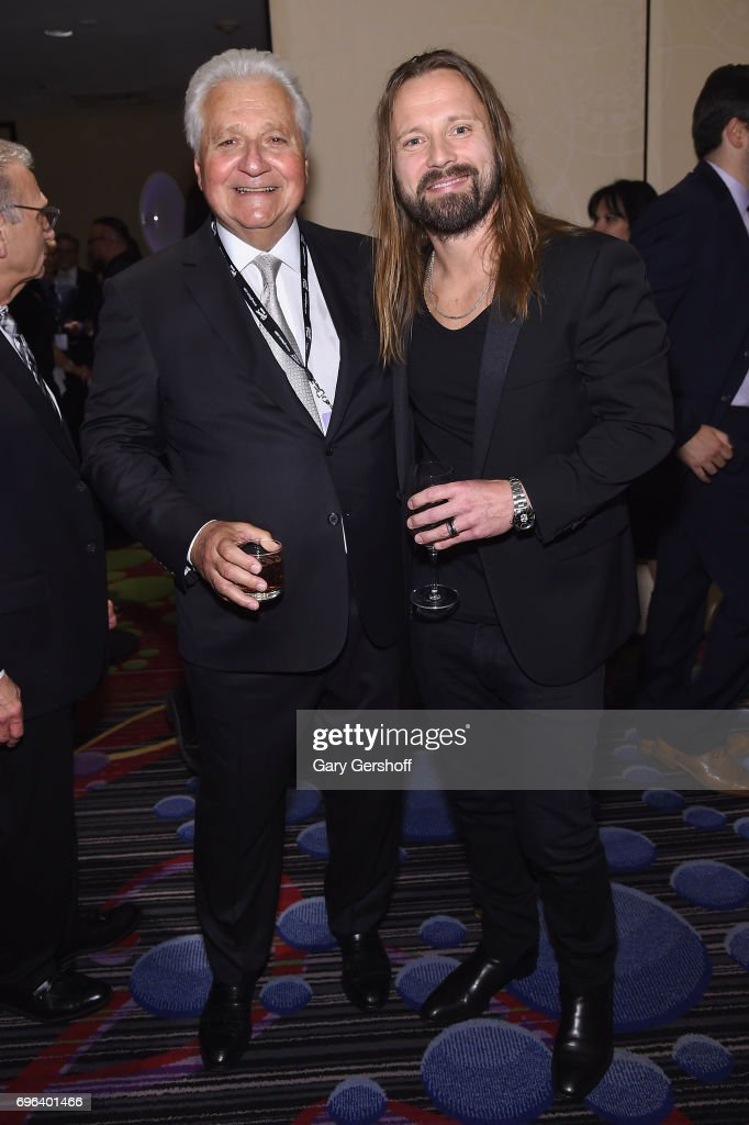 Chairman and CEO of Sony/ATV Music Publishing Martin Bandier and 2017 Inductee Max Martin pose backstage at the Songwriters Hall Of Fame 48th Annual Induction and Awards at New York Marriott Marquis Hotel on June 15, 2017 in New York City.