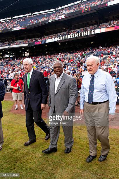 Chairman and CEO of the Atlanta Braves Terence McGuirk Hall of Famer Hank Aaron and Chairman Emeritus of the Atlanta Braves Bill Bartholomay walk...