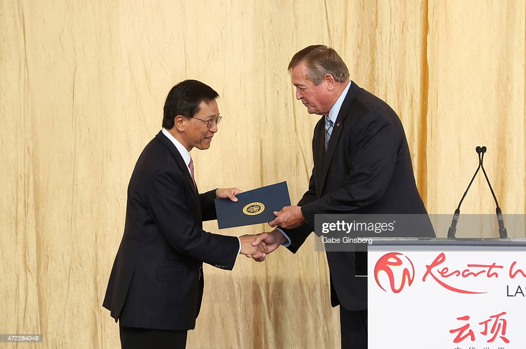 Chairman and CEO of the Genting Group K.T. Lim (L) recieves a proclamation from Rep. Cresent Hardy, R-Nev., during the Genting Group's ceremonial groundbreaking for Resorts World Las Vegas on May 5, 2015 in Las Vegas, Nevada. The USD 4 billion property on the Las Vegas Strip is expected to open in 2018 on the site of the former Stardust Resort & Casino.